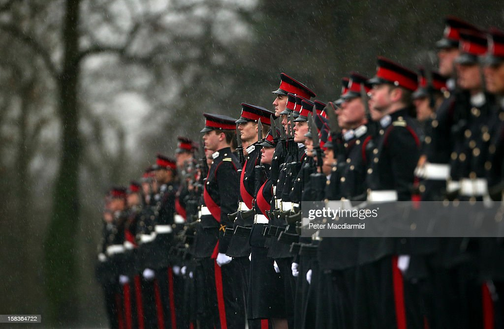 Cadets take part in the Sovereign's Parade in heavy rain at the Royal Military Academy at Sandhurst on December 14, 2012 in England. The parade marks the completion of 44 weeks of training for 200 young people who will be commissioned into the British Army and the armies of 13 overseas countries. Senior Under Officer Sarah Hunter-Choat became the fourth woman in the Royal Military Academy's history to receive the prestigious Sword of Honour which is awarded to the best Officer Cadet on the course.
