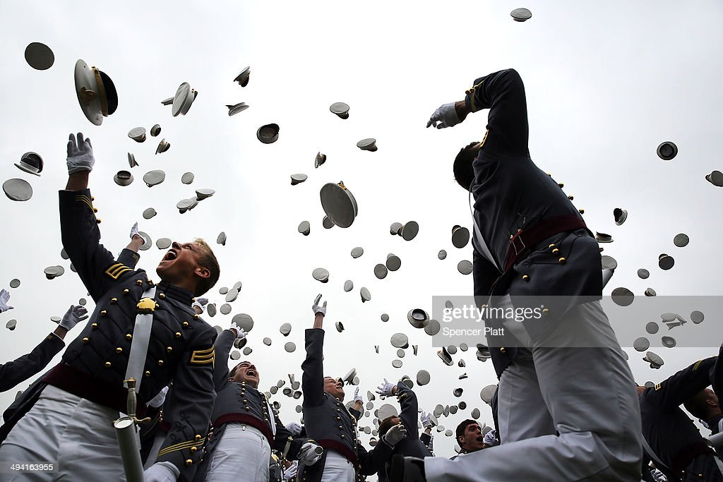 Cadets throw their hats in the air at the conclusion of the graduation ceremony at the US Military Academy at West Point on on May 28 2014 in West...