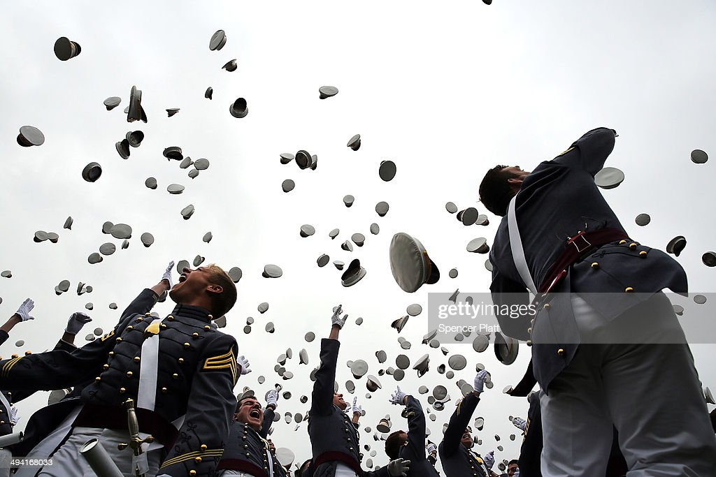 Cadets throw their hats in the air at the conclusion of the graduation ceremony at the US Military Academy at West Point on May 28 2014 in West Point...