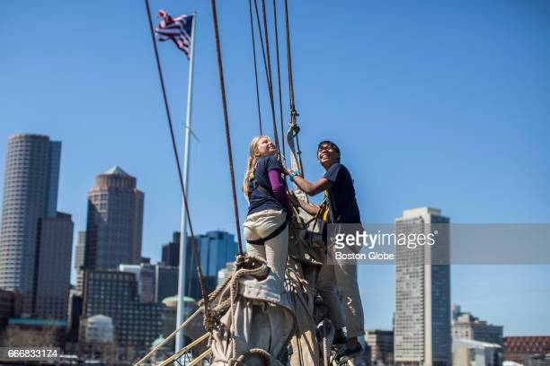 Cadets Tia Tiller and Nick Ng secure a sail on the Norwegian tall ship the Sørlandet as it sits docked at Fan Pier in Boston on Apr 9 2017 The tall...