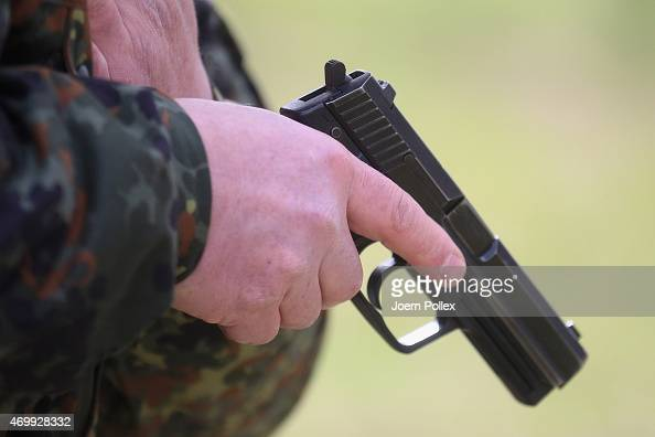 Cadets train with a P8 pistol at the noncommissioned officers' school of the German Navy on April 16 2015 in Ploen Germany The Bundeswehr the German...