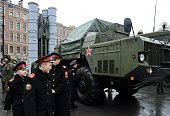 Cadets walk close to a Russian surfacetoair missile system S300 PMU during a military exhibition marking the upcoming Defenders of the Fatherland Day...