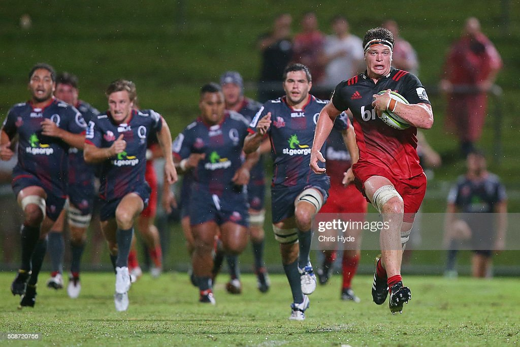 Cadeyn Neville of the Crusaders makes a break during the Super Rugby pre-season match between the Reds and the Crusaders at Ballymore Stadium on February 6, 2016 in Brisbane, Australia.