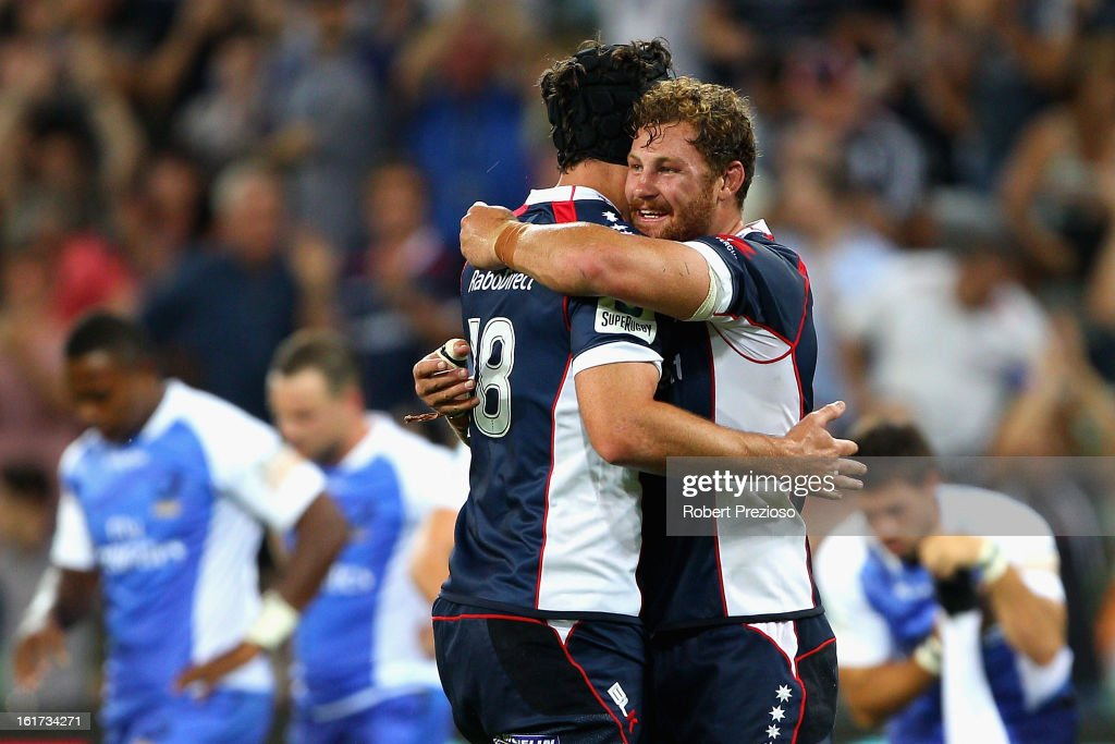 Cadeyrn Neville and Scott Higginbotham of the Rebels celebrate a win during the round one Super Rugby match between the Rebels and the Force at AAMI Park on February 15, 2013 in Melbourne, Australia.