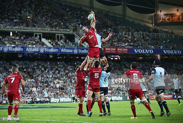 Cadeyrn Neville of the Reds and Jed Holloway of the Waratahs jump at the lineout during the round one Super Rugby match between the Waratahs and the...