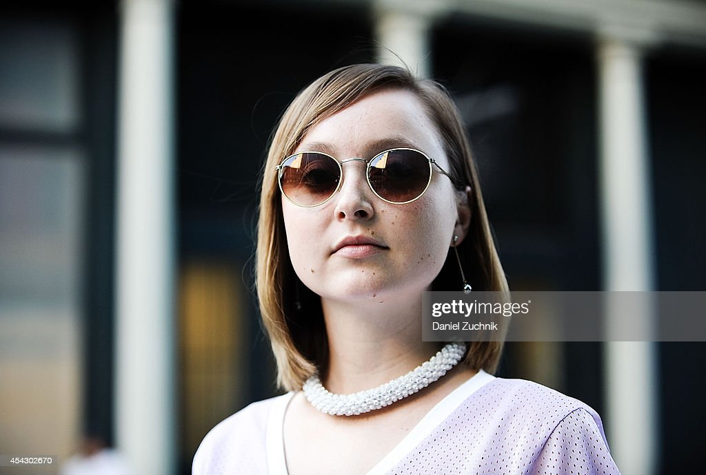 Cadiar Du'Jour is seen around Soho wearing a Zara top and vintage sunglasses on August 28, 2014 in New York City.
