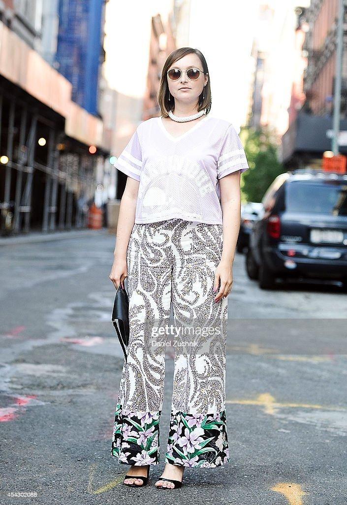 Cadiar Du'Jour is seen around Soho wearing a Zara top, Elle Tahari pants, Anthropologie bag and vintage sunglasses on August 28, 2014 in New York City.