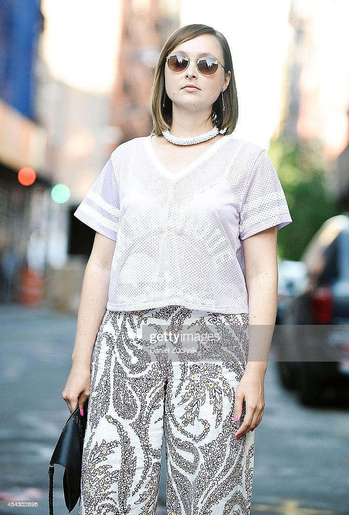 Cadiar Du'Jour is seen around Soho wearing a Zara top, Elle Tahari pants, Anthropologie bag and vintage sunglasses on August 28, 2014 in New York City.