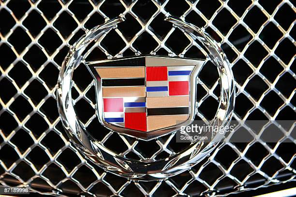 Cadillac emblem decorates the grill of an Escalade offered for sale at Grossinger's GM dealership May 13 2009 in Lincolnwood Illinois In an attempt...