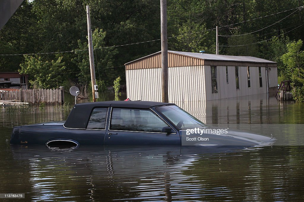 Cadillac is seen in floodwater from the Ohio River May 5 2011 in Paducah Kentucky Heavy rains have left the ground saturated rivers swollen and have...