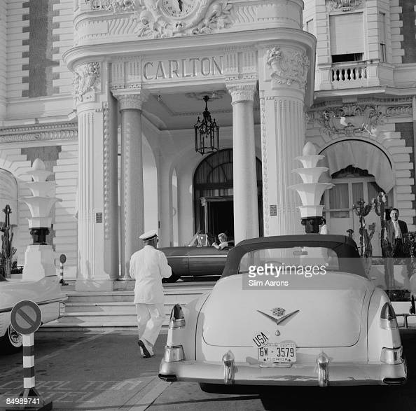 A Cadillac with Florida plates parked outside the Carlton Hotel Cannes France circa 1955
