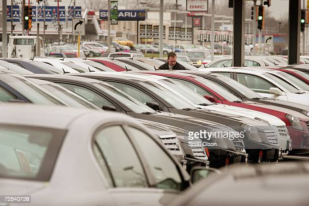 Cadillacs are parked on a dealership lot November 14 2006 in Countryside Illinois Inflation at the wholesale level fell 16 percent last month driven...