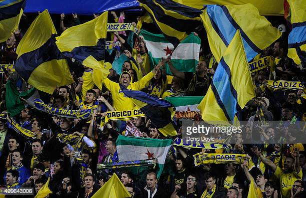Cadiz fans cheer on their team during the Copa del Rey Round of 32 First Leg match between Cadiz and Real Madrid at Ramon de Carranza stadium on...