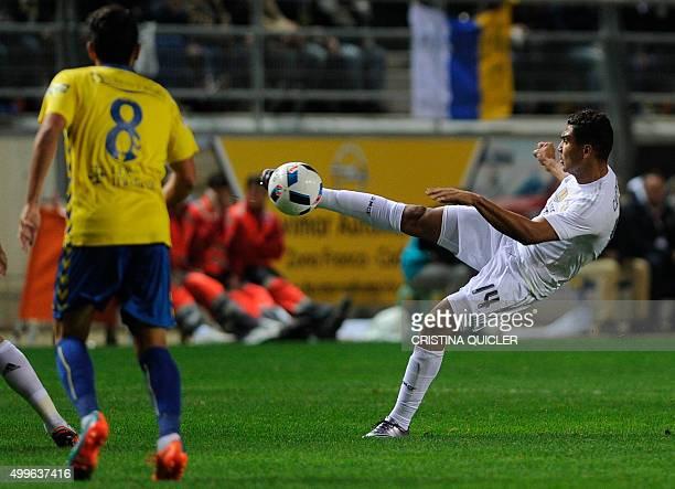 Cadiz's midfielder Mantecon vies with Real Madrid's Brazilian midfielder Casimiro during the Spanish Copa del Rey football match Cadiz CF vs Real...