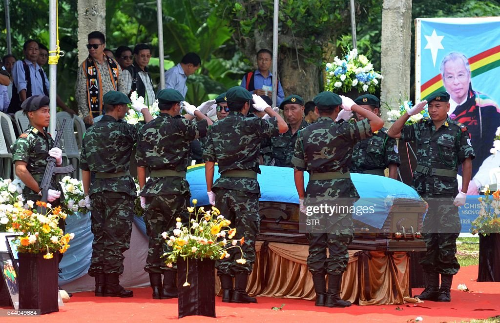 Cadres of The National Socialist Council of Nagaland-Isak Muivah (NSCN-IM) salute the coffin bearing the body of Chairman Isak Chishi Swu after his state funeral service on the outkirts of Dimapur on July 1, 2016, ahead of the cortege departure to his ancestral village of Chishilimi, in the north-eastern Indian state of Nagaland. IM was formed in 1980 by Muivah and Swu and others with the objective of establishing a sovereign state for Naga tribes in north-east India and northern Burma. The Indian government signed a 'peace treaty with the NSCN-IM in August 2015. Swu died in the Indian capital New Delhi on June 28, after a long illness. / AFP / STR