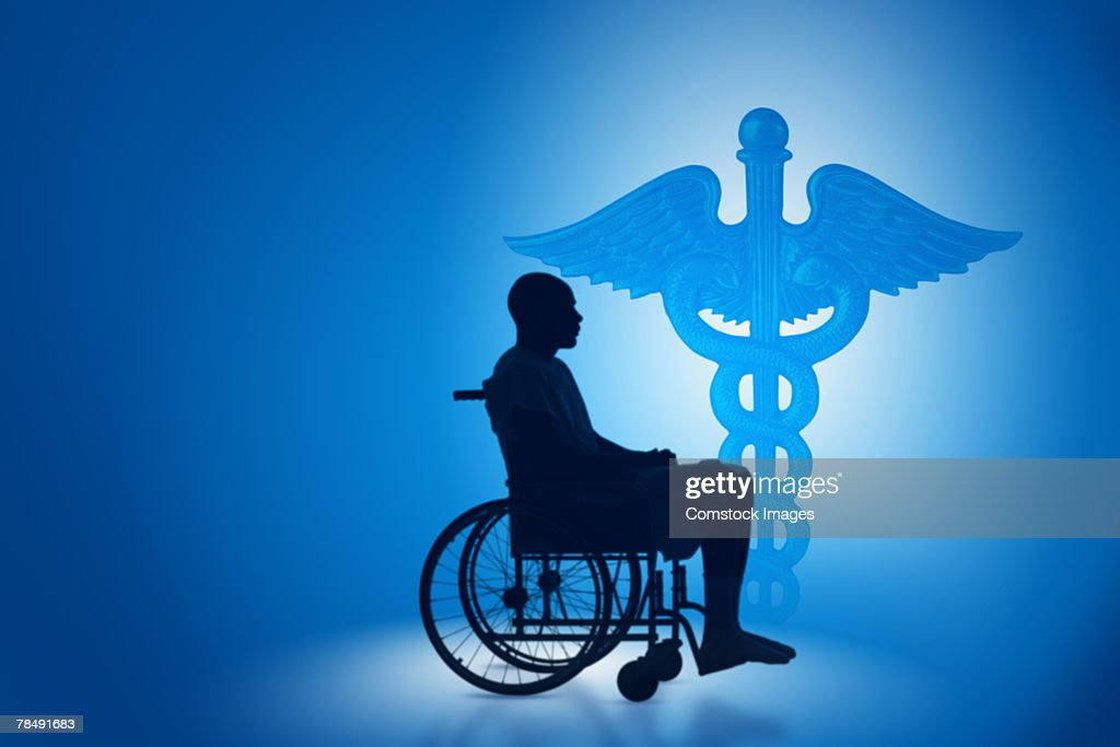 Caduceus and silhouette of man in wheelchair