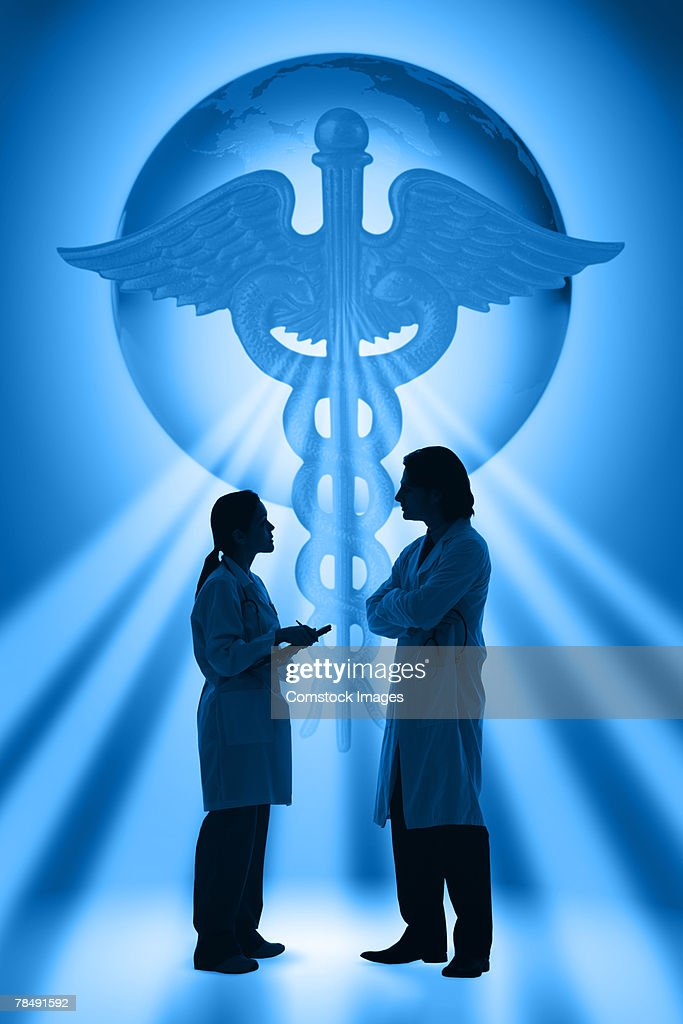 Caduceus and world over doctors conversing