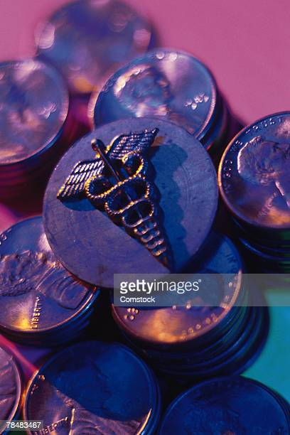 Caduceus symbol on top of penny stacks