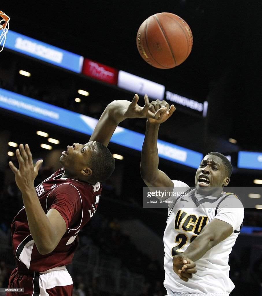 Cady Lalanne #25 of the Massachusetts Minutemen and Jarred Guest #23 of Virginia Commonweath Rams fight for a rebound during the first half during the Atlantic 10 Basketball Tournament - Semifinals at the Barclays Center on March 16, 2013 in the Brooklyn borough of New York City.