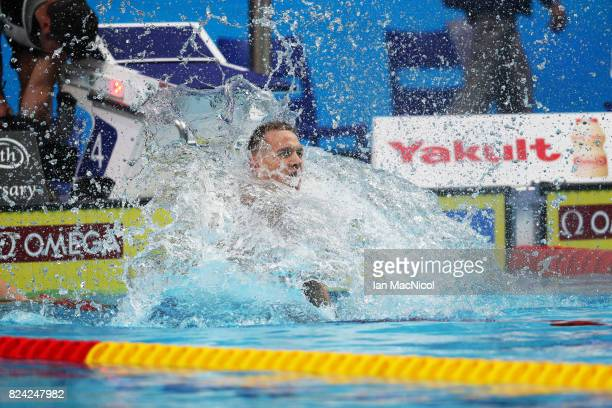 Caeleb Dresel of United States reacts after wining the Men's i00m Butterfly final during the FINA World Championships at the Duna Arena on day...