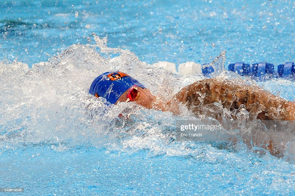 Caeleb Dressel competes in a preliminary heat of the Men's 100 meter freestyle during Day 4 of the 2016 U.S. Olympic Team Swimming Trials at CenturyLink Center on June 29, 2016 in Omaha, Nebraska.