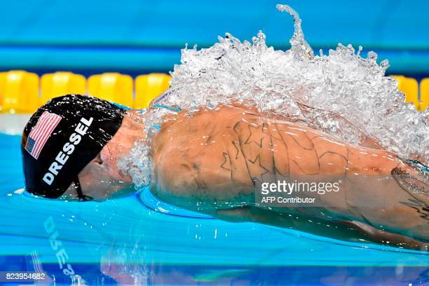 US Caeleb Remel Dressel competes in the men's 100m butterfly semifinal during the swimming competition at the 2017 FINA World Championships in...