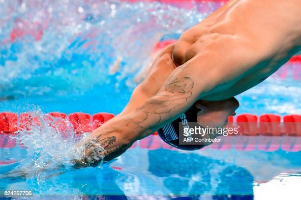 US Caeleb Remel Dressel competes in the mixed 4x100m freestyle final during the swimming competition at the 2017 FINA World Championships in Budapest...