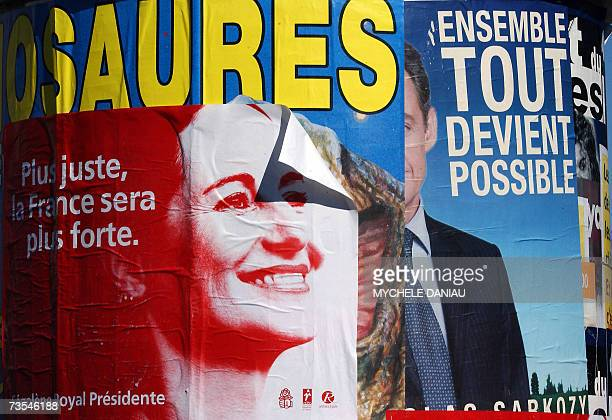 A Campaign poster of the French Socialist presidential candidate Segolene Royal is pasted on a column next to French rightwing candidate Nicolas...