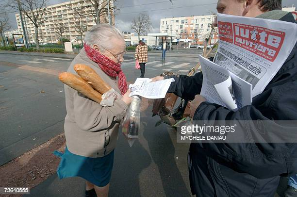 A militant of French farleft party Lutte Ouvriere presidential candidate Arlette Laguiller sells the party weekly magazine and delivers leaflets 20...