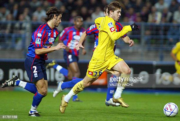 Sochaux' forward Jeremy Menez vies with Caen's defender Nicolas Seube during their French L1 football match 06 November 2004 at the Michel D'Ornano...