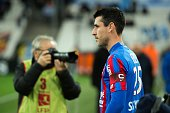 Caen midfielder and captain Julien Feret enters the field on February 27 2015 before a French L1 football match Olympique de Marseille vs Stade...