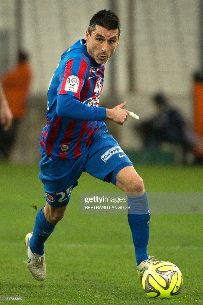 Caen midfielder and captain <a gi-track='captionPersonalityLinkClicked' href=/galleries/search?phrase=Julien+Feret&family=editorial&specificpeople=4110266 ng-click='$event.stopPropagation()'>Julien Feret</a> plays on February 27, 2015 during a French L1 football match Olympique de Marseille vs. Stade Malherbe de Caen at the Velodrome stadium in the southern French city of Marseille. LANGLOIS