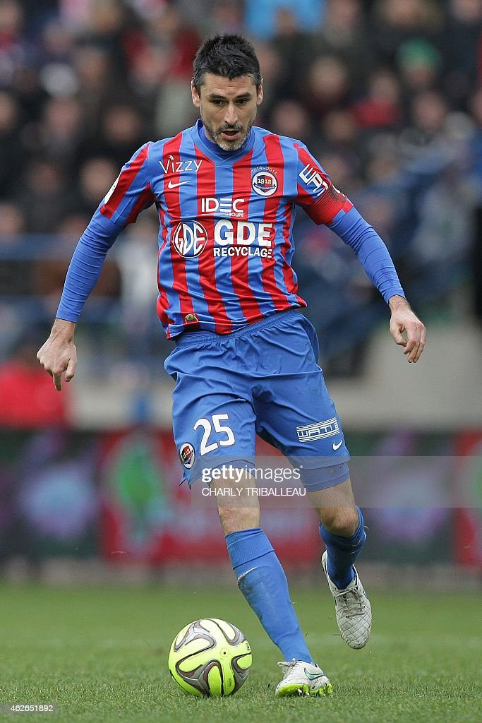 Caen midfielder Julien Feret runs with the ball on February 1 2015 during a French L1 football match between Caen and SaintEtienne at the Michel...