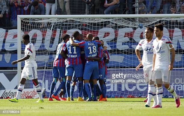 Caen players celebrates after French forward Nicolas Benezet scored during the French L1 football match between Caen and Lyon at the Michel d'Ornano...
