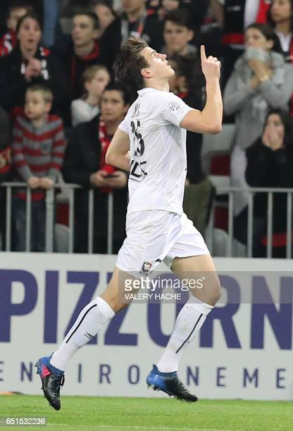 Caen's Croatian forward Ivan Santini celebrates after scoring a goal during the French L1 football match Nice vs Caen on March 10 2017 at the Allianz...