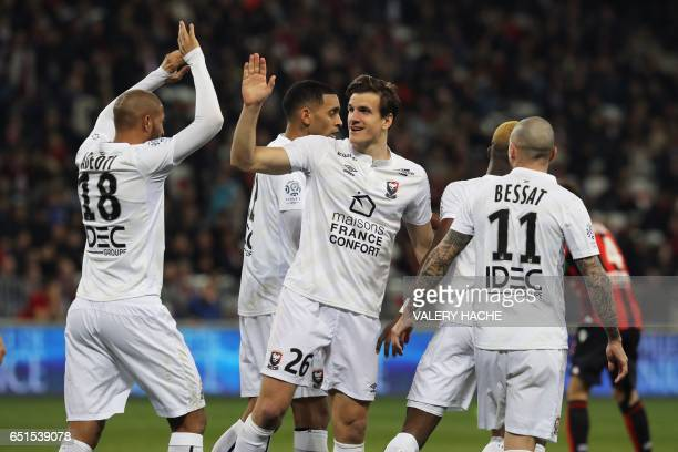 Caen's Croatian forward Ivan Santini celebrates with Caen's FrenchBeninese midfielder Jordan Adeoti after Caen's French forward Yann Karamoh scored a...