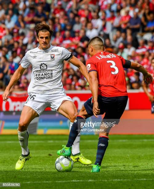 Caen's Croatian forward Ivan Santini fights for the ball with Lille's Paraguay defender Junior Alonso during the French L1 football match Lille vs...