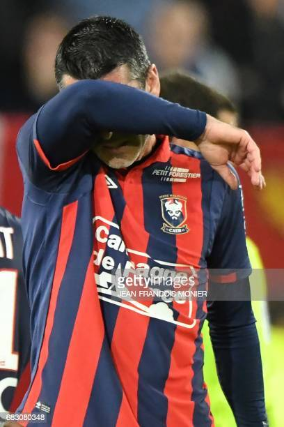 Caen's Croatian forward Ivan Santini reacts at the end of the French L1 football match between Caen and Rennes on May 14 at the Michel d'Ornano...