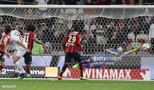 Caen's Croatian forward Ivan Santini scores a goal during the French L1 football match Nice vs Caen on March 10 2017 at the Allianz Riviera stadium...