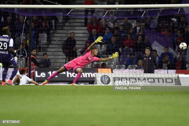 Caen's Croatian forward Ivan Santini scores a goal during the French L1 football match between Toulouse and Caen on May 6 2017 at the Municipal...