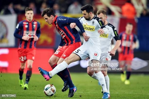 Caen's Croatian forward Ivan Santini vies for the ball with Angers' French midfielder Thomas Mangani during the French L1 football match between Caen...