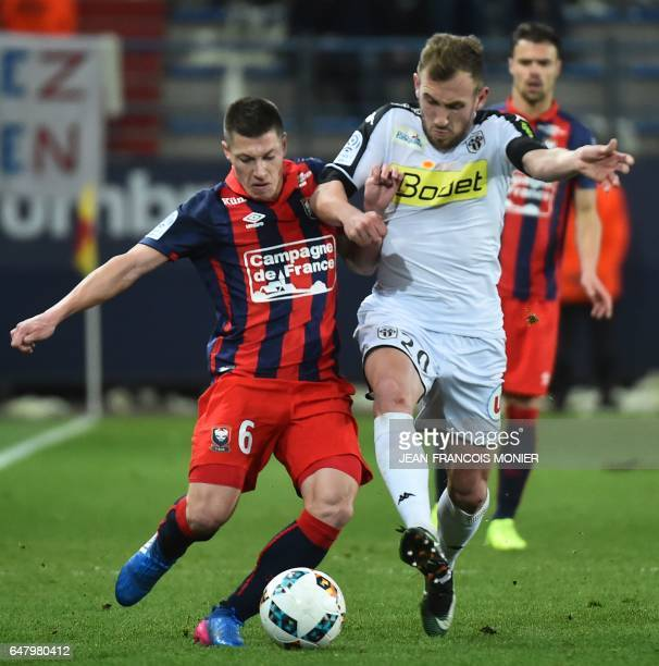 Caen's Croatian forward Ivan Santini vies for the ball with Angers' French defender Romain Thomas during the French L1 football match between Caen...