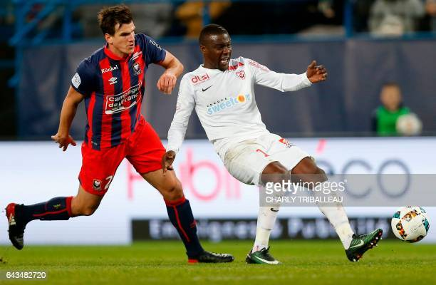 Caen's Croatian forward Ivan Santini vies for the ball with Nancy's French defender Faitout Maouassa during the French L1 football match between Caen...
