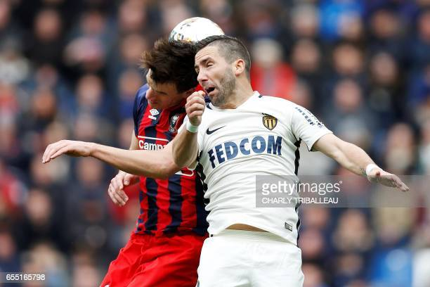 Caen's Croatian forward Ivan Santini vies with Monaco's Portuguese midfielder Joao Moutinho during the French L1 football match between Caen and...