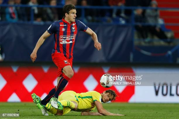 Caen's Croatian forward Ivan Santini vies with Nantes' Belgian midfielder Guillaume Gillet during the French L1 football match between Caen and...