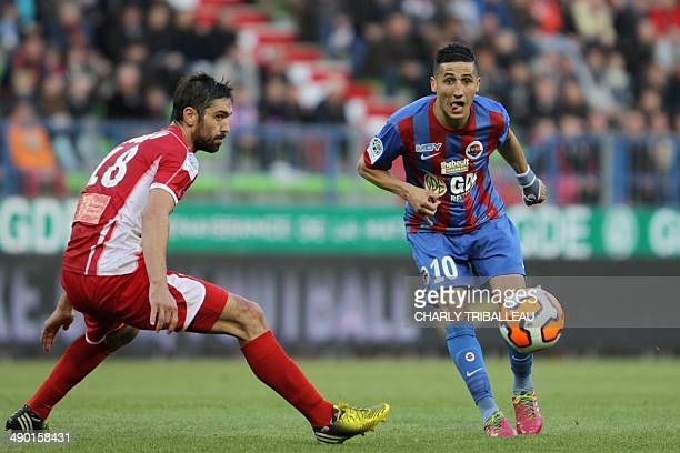 Caen's Faycal Fajr vies with Nimes' Benoit Poulain during the French L2 football match Caen vs Nimes at the Michel d'Ornano stadium in Caen on May 13...