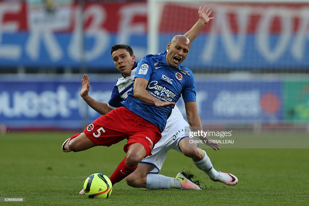 Caen's French defender Ala eddine Yahia (L) vies with Bastia's French forward Julien Romain during the French L1 football match between Caen (SM Caen) and Bastia (SC Bastia), on April 30, 2016 at the Michel d'Ornano stadium, in Caen, northwestern France.
