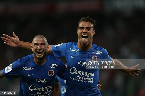 Caen's French defender Damien Da Silva celebrates with his teammate French midfielder Vincent Bessat after scoring during the French L1 football...