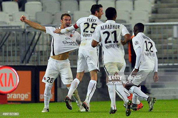 Caen's French defender Damien Da Silva celebrates with teammates after scoring a goal during the French L1 football match between Bordeaux and Caen...