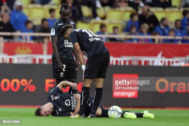 Caen's French defender Damien Da Silva lies in pain on the pitch after being nudged during the French L1 football match Monaco vs Caen on October 21...
